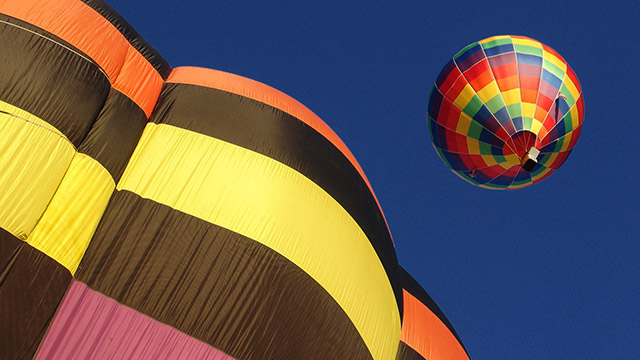 Vivid colors of flying hot air ballons under blue sky